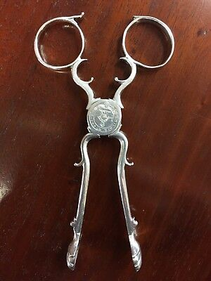 Antique Solid Silver Sugar Tongs With Crest 'vigilate Et Orate'