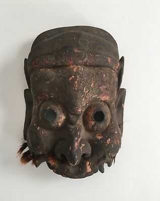Hand carved wooden 19th c Chinese mask with traces of original gilding
