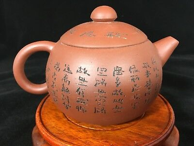Round Yixing teapot with lettering.
