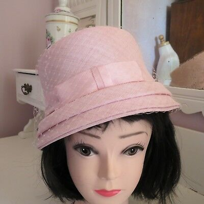 Pale pink vintage fabric hat with gross grain ribbon bow and netting race wear