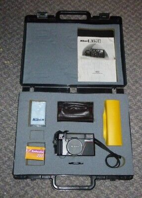 Nikon L35 AF camera & accessories in the original presentation briefcase