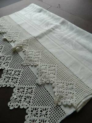 Antique UNUSED Irish linen damask towel with crochet lace trim.