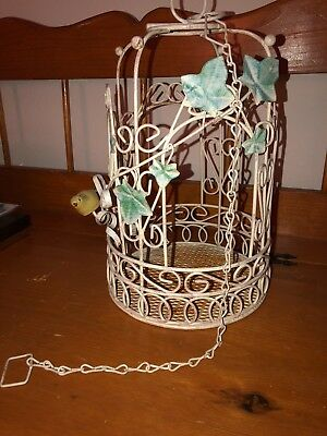 Vintage Metal bird cage with tiny bird, antique white, green leaves, with chain.