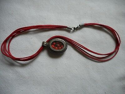 Vintage sterling pendant with dried huayruro seeds,brings luck,reject bad energy