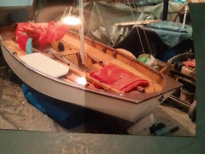 small sailing boat stored undercover be re-varnished comes with launching trolle