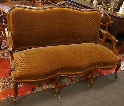 French Louis style nineteenth century salon sofa with ornate carved wood frame