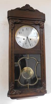 pretty oak cased ting tang wall clock