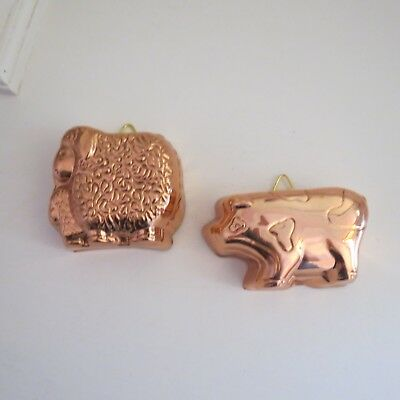 Two small copper anodised moulds sheep & pig