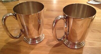 A Pair of  Vintage silver plated 1 pint tankards.