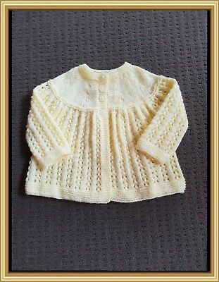 Lovely lemon 4ply H/knitted matinee jacket..000