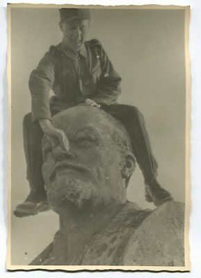 German Wwii Archive Photo: Wehrmacht Soldier Sitting On Top Of Lenin Monument