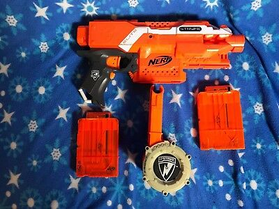 Orange Nerf N-STRIKE ELITE STRYFE w/ x2 6 Round Clip, Drum Mag, and 24 Bullets