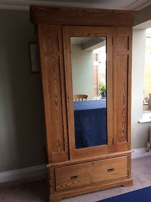 Antique Pitch  pine single wardrobe with field panels, mirror and bottom drawer