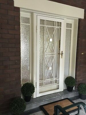 As-new, solid steel, art-deco security doors with polished brass detailing