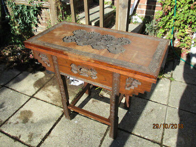Antique oriental carved card table
