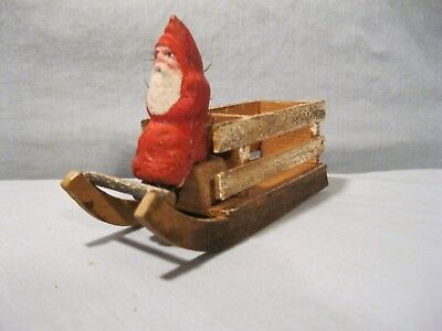 German Santa in sleigh w/feather tree