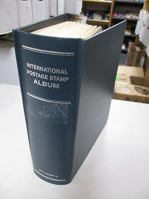 US SCOTT INTERNATIONAL STAMP ALBUM w/ PAGES A-Z for 1985 and ABOUT 270 STAMPS