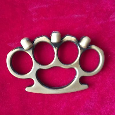 Brown skull four fingers button outdoor self-defense tools.
