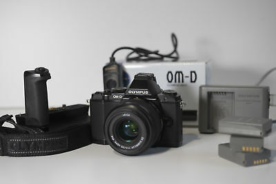 Olympus OM-D EM-5 + HLD-6 grip + 3 batteries , charger and more