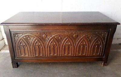 Antique oak chest with carved front. 39 inches wide. T8