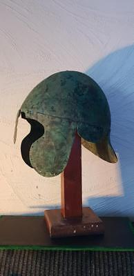 A very nice greek chalcidian bronze helmet intact with bespoke wood stand