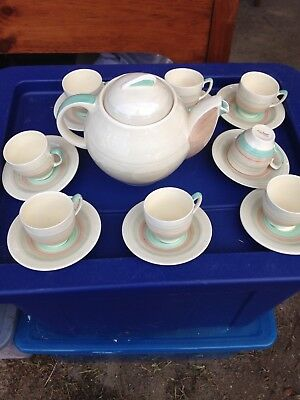 Susie Cooper Art Deco Teapot and eight small cups and saucers, England Green/tan