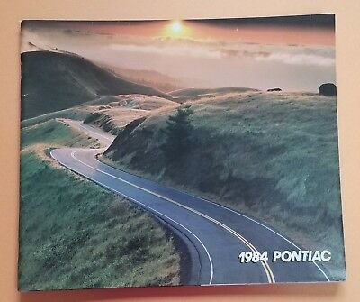 1984 PONTIAC Deluxe Full Line Showroom Brochure thick Catalog 80 pages