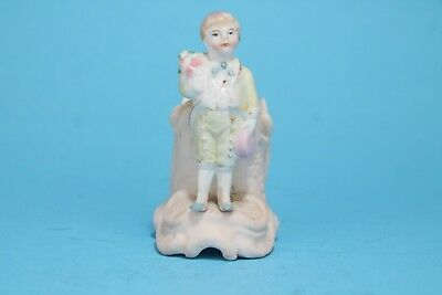 Vintage Porcelain Little boy holding flowers and a gift