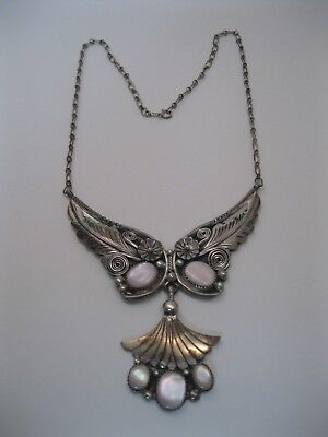 Lot 66 - Vintage Navajo Silver & Pink Mussel Shell Necklace w Foliate Design