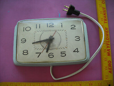 Vintage General Electric Mid-Century Teal Electric Wall Clock Model 2H113