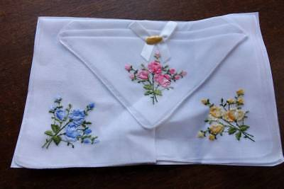 Set of three ladies UNUSED vintage white hankies - floral embroidery detail.