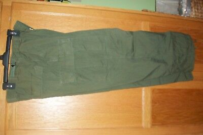 US Military Tropical pants size regular medium --no holes or strains