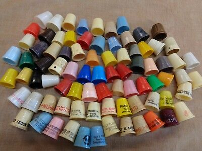 80 assorted advertising plastic  sewing thimbles