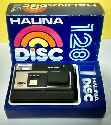 1980s HALINA DISC CAMERA Model 128 with flip-over Tele lens. Working.