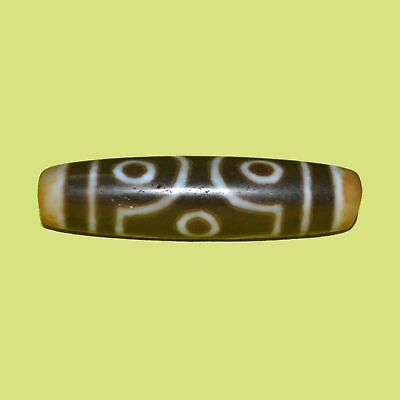 Rare museum quality 6-eye dZi bead with unique color