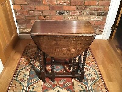 Table with gate leg and barley twist legs. Solid oak, used, but good condition.