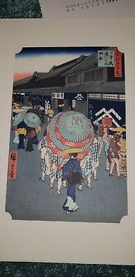 Japanese woodblock print of a geisha and umbrellas