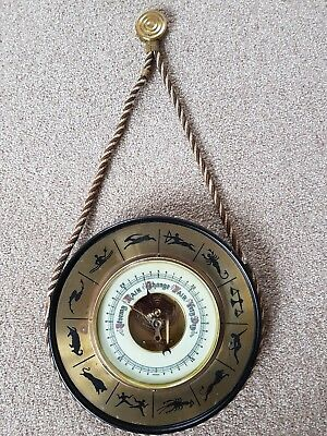 Large old barometer with Zodiac signs