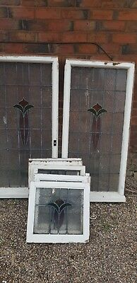 Antique 1930s leaded stained glass windows.