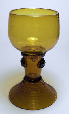 An amber glass roemer with ribbed foot, Dutch/German c.1800