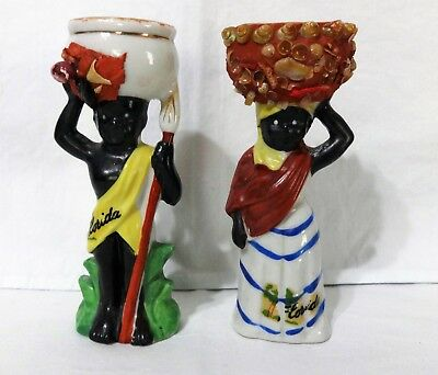 """vintage Florida souvenirs -Two (2) Figurines with pails on heads  - 4 1/2"""" tall"""