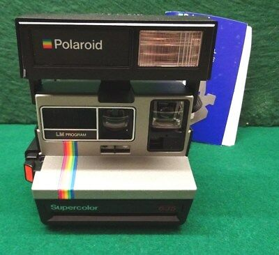 Polaroid Supercolor 635 Instant Camera With Paperwork.