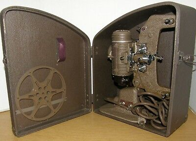 BELL AND HOWELL Regent 122L 8mm movie projector case reel