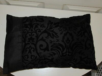 Beautiful black silky cushion with velvety embossed pattern