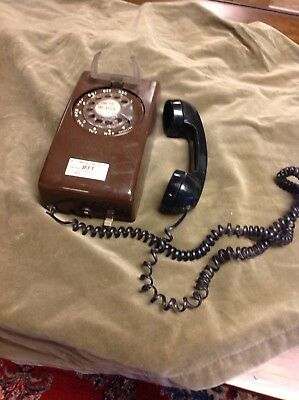 Vintage  Rotary Dial Wall Telephone Phone Brown with a black handle. Retro