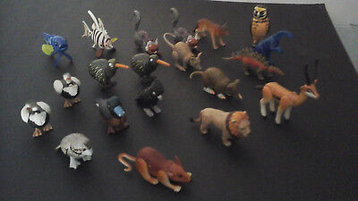 20 x mixed Yowie toys with papers
