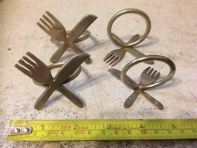 Set Of Four Ss Napkin Rings In Form Of Knife And Forks