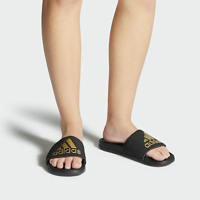 f5189a6b62ac4 Women s Adidas Adillette Cloudfoam plus Logo slides Black Gold Sandals  B41742