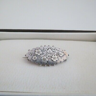 Antique sterling silver brooch engraved with flowers hallmarked for 1892