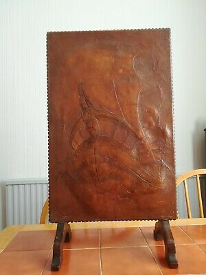 British arts and crafts fire screen. Covered with leather. With embossed Galleon